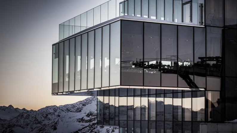 Glass building in the Austrian Alps